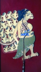 Wayang puppet figure of a peasant woman depicted as dim-witted for having so many children on her back